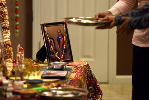 A photograph of Rekhaben Shah holds a special place on the altar of Kaushal Shah, Rekhaben's son.
