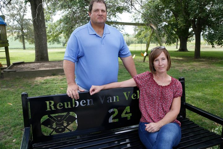 At their home in Oskaloosa, Iowa, Scott and Sandy Van Veldhuizen sit on a bench given to them by families of children who pla