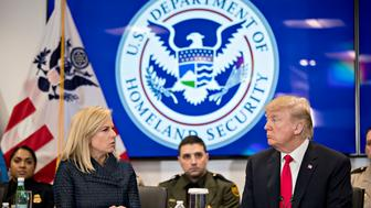 STERLING, VA - FEBRUARY 2:  (AFP OUT) U.S. President Donald Trump, right, listens as Kirstjen Nielsen, secretary of Homeland Security, speaks during a Customs and Border Protection (CBP) roundtable discussion at the CBP National Targeting Center February 2, 2018 in Sterling, Virginia. Trump is looking to ratchet up pressure on lawmakers to consider the immigration proposal he unveiled in Tuesday's State of the Union using the visit as an opportunity to again argue his proposal would bolster the country's borders. (Photo by Andrew Harrer-Pool/Getty Images)