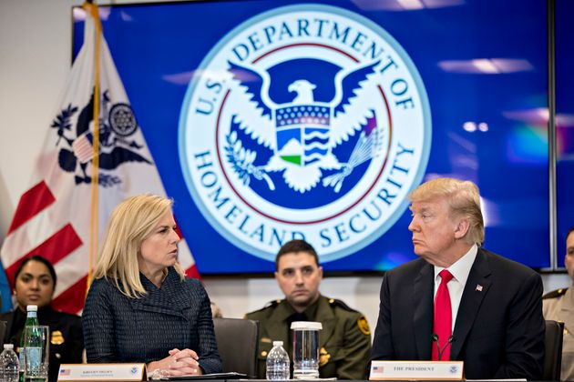 President Donald Trump listens as Kirstjen Nielsen, secretary of Homeland Security, speaks during a Customs...