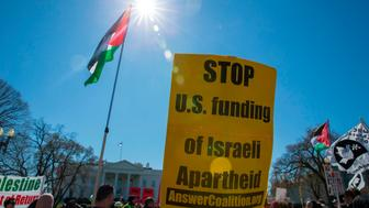 A sign is held by demonstrators calling for an independent Palestinian state during a protest held outside the White House in Washington, DC on March 4, 2018. / AFP PHOTO / Alex Edelman        (Photo credit should read ALEX EDELMAN/AFP/Getty Images)