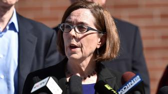 Oregon Governor Kate Brown reacts during a press conference in Roseburg, Oregon on October 2, 2015. As police and mourners groped for answers in the latest carnage to hit gun-crazed America, a portrait started to emerge Friday of the Oregon community college shooter: an angry recluse who hated religion. The rampage Thursday by a heavily armed young man identified as Chris Harper Mercer, 26, left 10 dead and shattered a close-knit rural community in the south of the state. AFP PHOTO/JOSH EDELSON        (Photo credit should read Josh Edelson/AFP/Getty Images)
