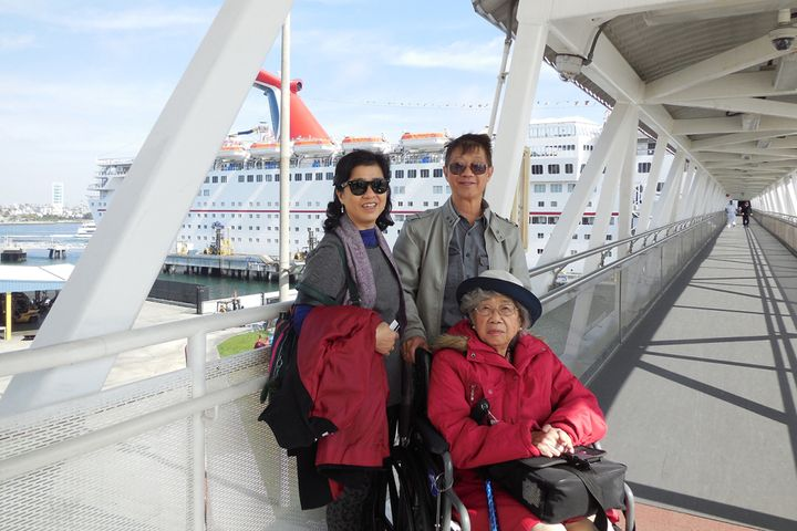 Two months before her upper-spine surgery in 2014, Paulina Tam (left) took a cruise to Mexico with her husband, Timothy, and