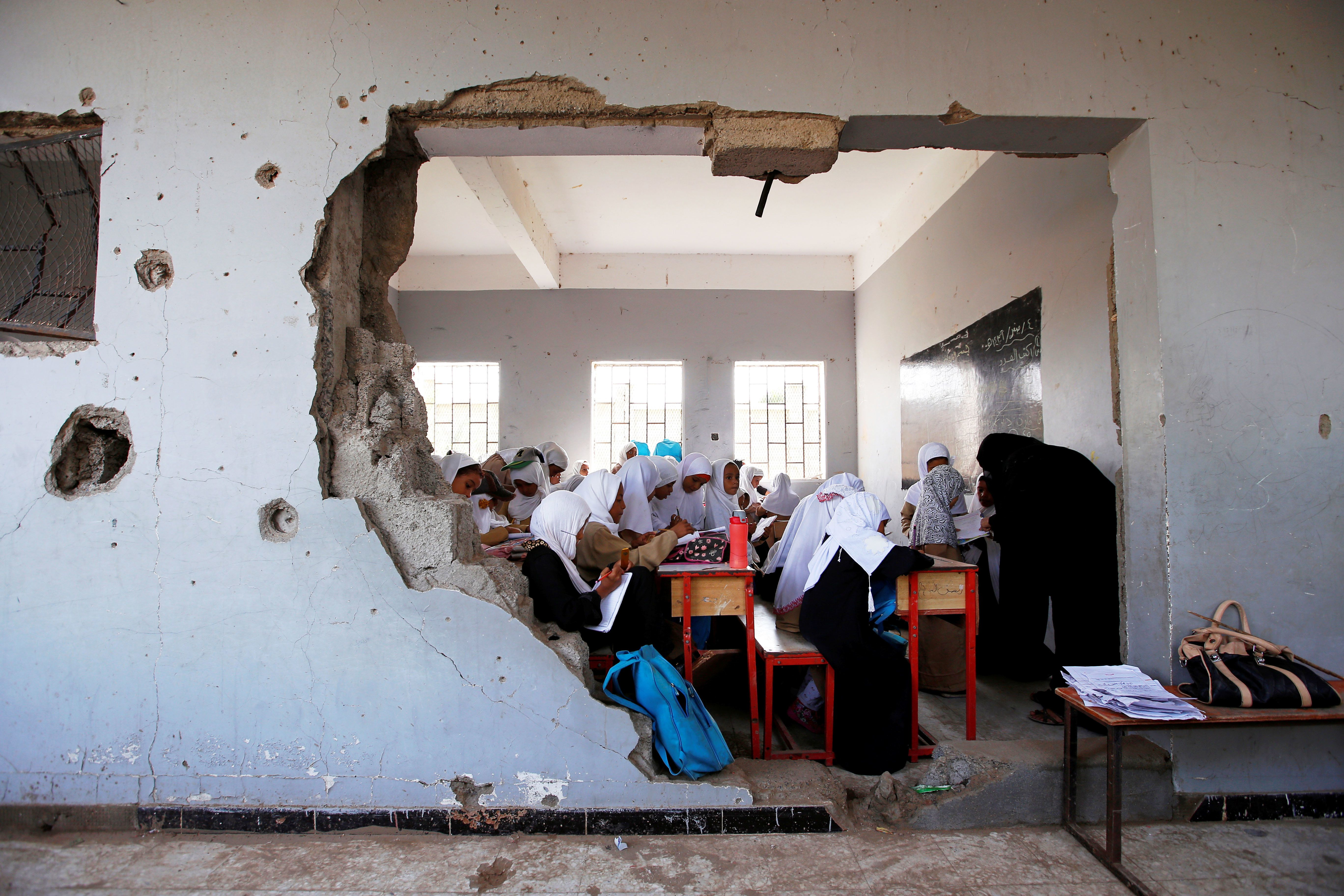 Girls attend a class at their school (damaged by a recent Saudi-led air strike) in the Red Sea port city of Hodeidah, Yemen,