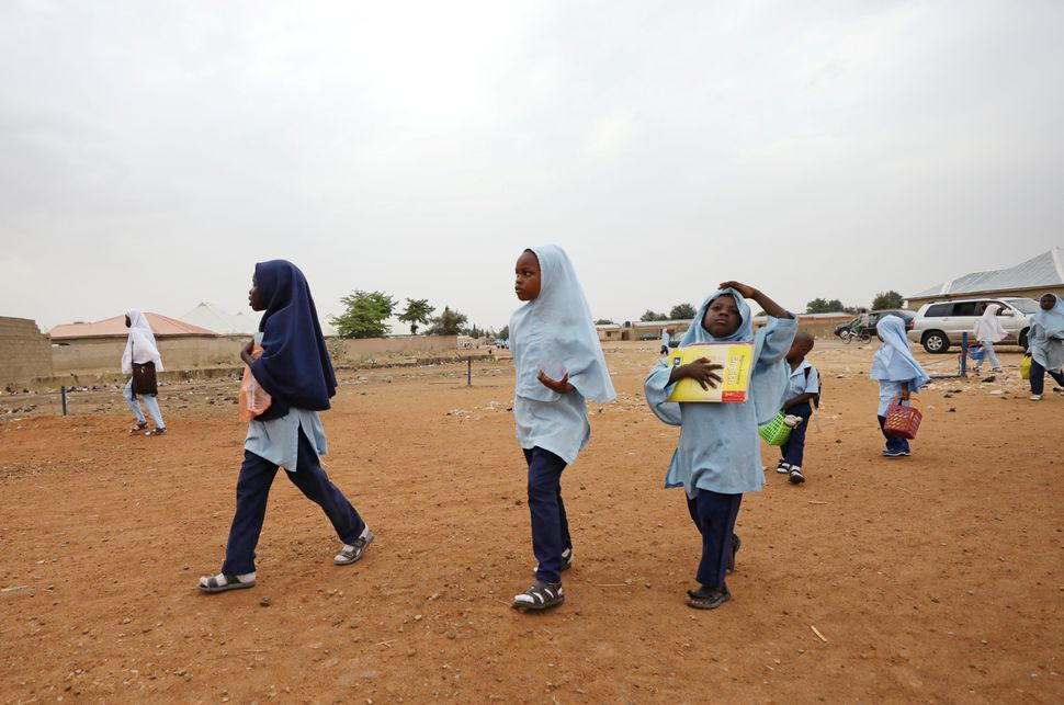 Girls walk to school in the northeastern city of Damaturu, Nigeria, onFeb. 23, 2018.