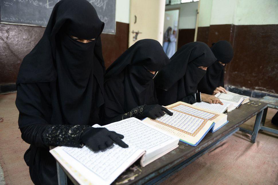 Indian Muslim girls recite the Koran at the Madrasatur-Rashaad religious school in Hyderabad, India, on June 19, 2017.
