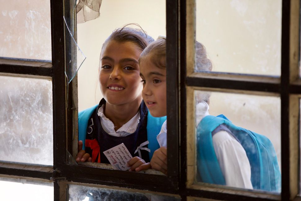 Two schoolgirls at a school in West Mosul, Iraq, on Aug. 2, 2017.