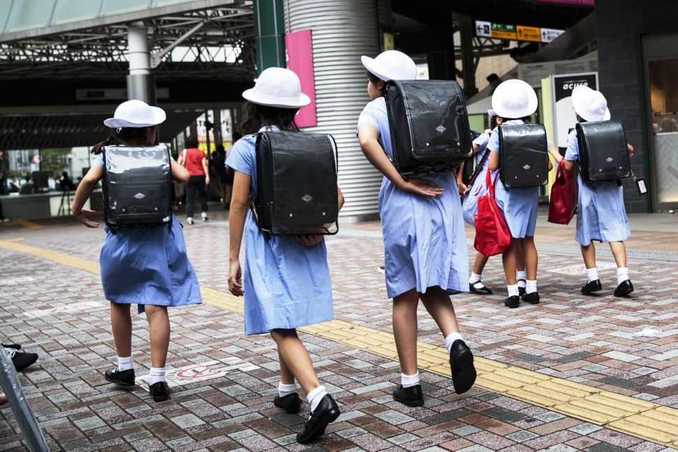 School girls walk home at Ebisu district in Tokyo, Japan, onSept. 4, 2017.