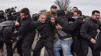 Members of the alt-right including members of the Traditionalist Workers Party fight with protesters outside of a Richard Spencer speech on the campus of Michigan State University in East Lansing, Michigan, U.S., March 5, 2018. REUTERS/Stephanie Keith