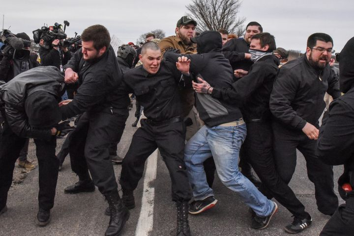 Members of the so-called alt-right, including members of the Traditionalist Worker Party, fight with protesters outside of a