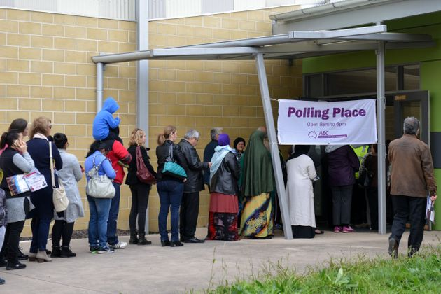 Australian voters line up on election day to determine all 226 members of theParliament in Melbourne...