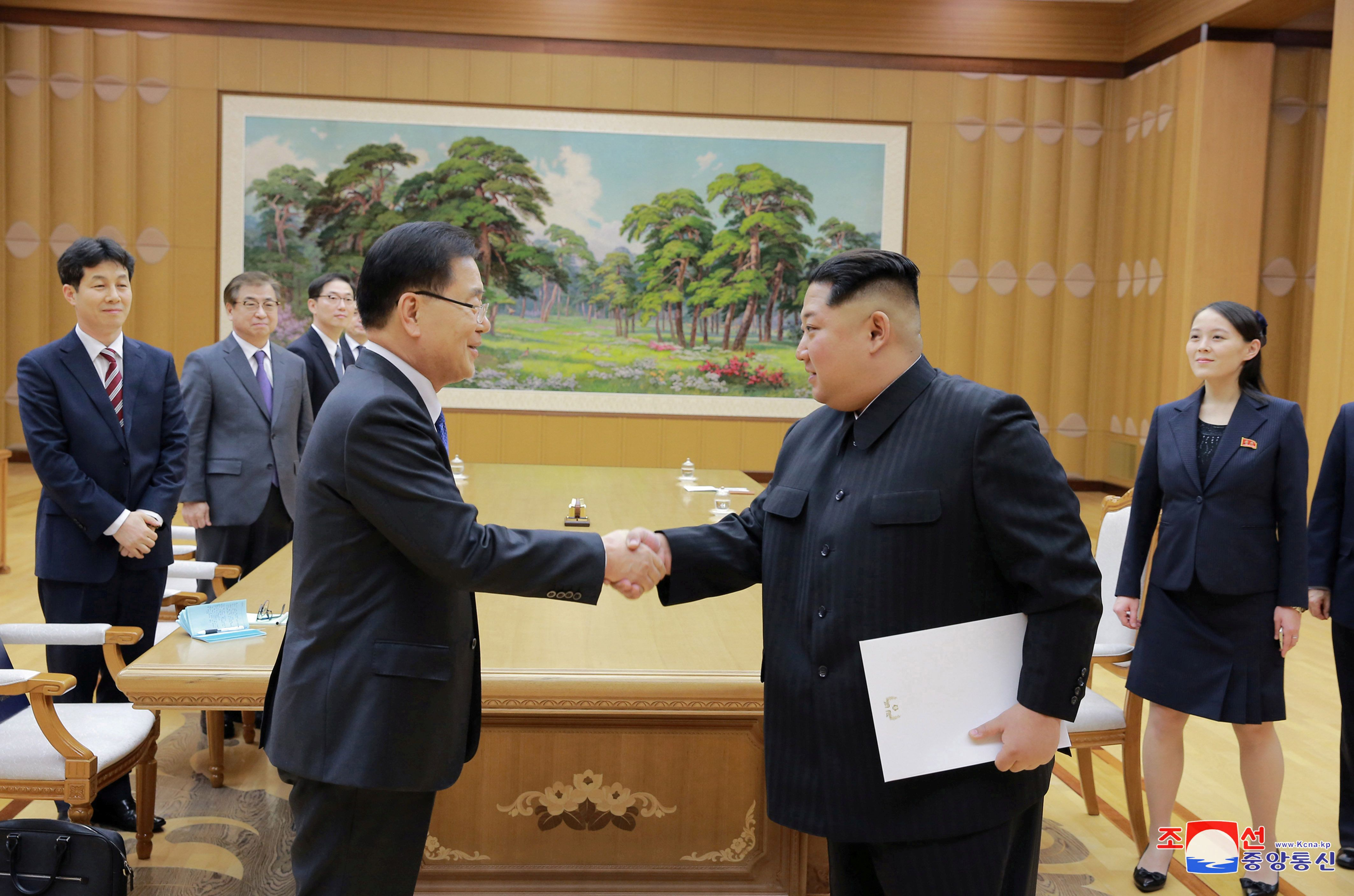 North Korean leader Kim Jong Un shakes hands with Chung Eui-yong who is leading a special delegation of South Korea's President, in this photo released by North Korea's Korean Central News Agency (KCNA) on March 6, 2018. KCNA/via Reuters   ATTENTION EDITORS - THIS PICTURE WAS PROVIDED BY A THIRD PARTY. REUTERS IS UNABLE TO INDEPENDENTLY VERIFY THE AUTHENTICITY, CONTENT, LOCATION OR DATE OF THIS IMAGE. NO THIRD PARTY SALES. SOUTH KOREA OUT.     TPX IMAGES OF THE DAY