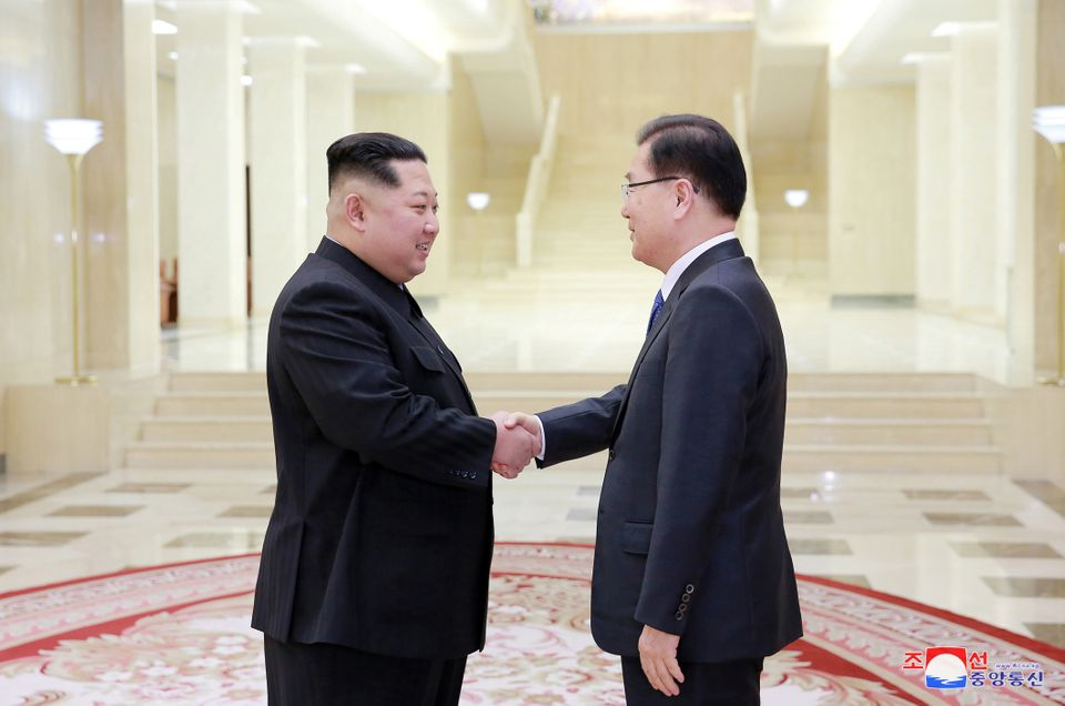 North Korean leader Kim Jong Un shakes hands with a member of the special delegation of South Korea's President in this photo