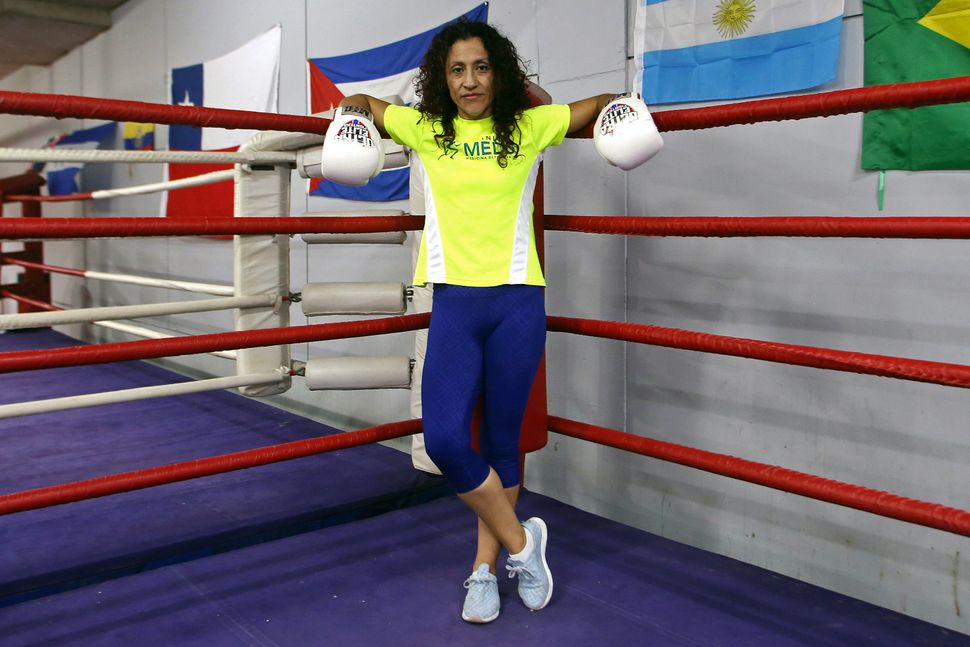 "Boxer Carolina ""Crespita"" Rodriguez, 34, poses for a picture in Santiago, Chile, on March 1, 2018."