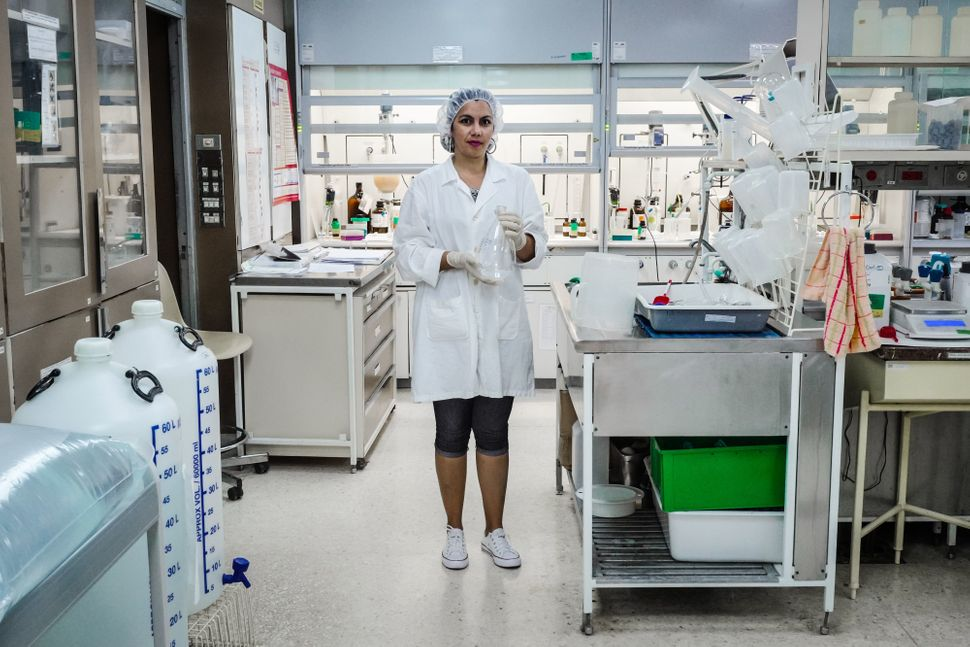Yordanka Masfollor, 34, has a Ph.D. in chemical sciences. Here she poses for a picture at a biotechnology laboratory in
