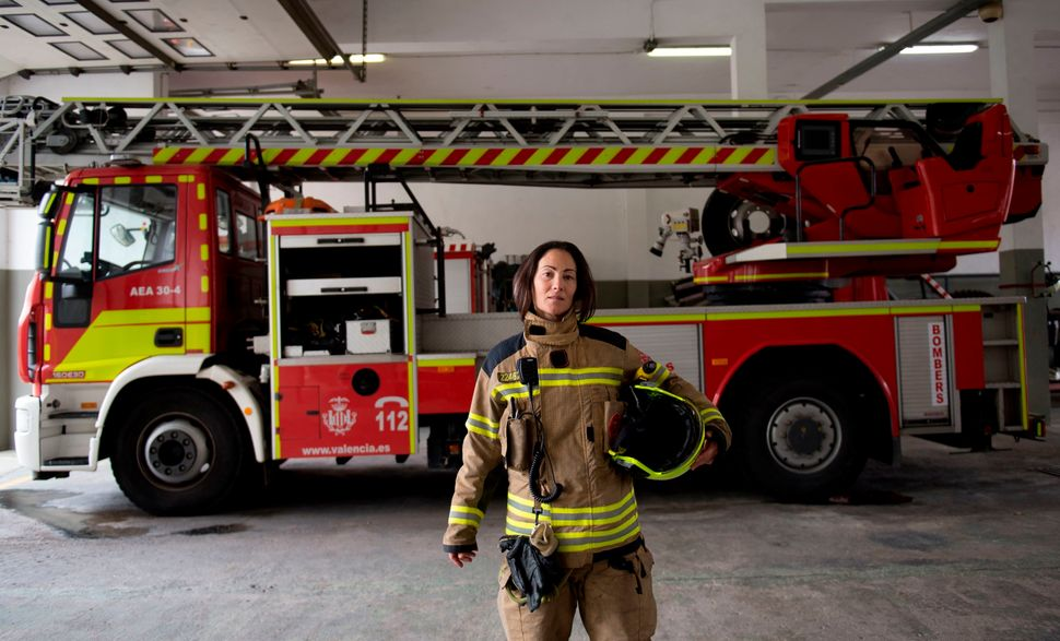 Firefighter Maria Jose Martienz Ortiz, 43, poses for a picture in the Fuente San Luis fire station in Valencia, Spain, on&nbs