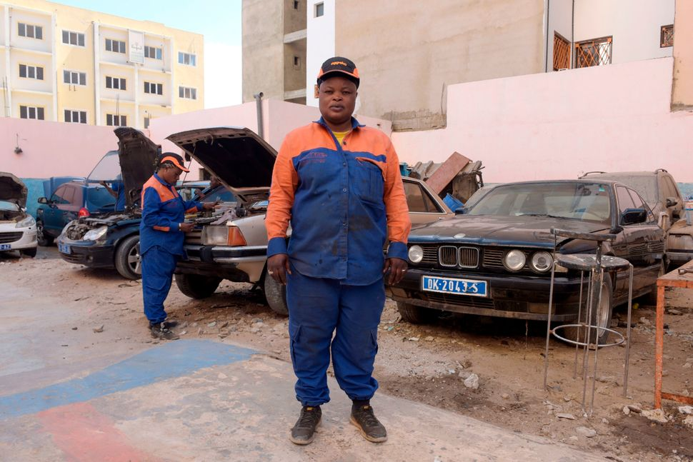 Mechanic and garage co-owner Fatou Sylla poses onFeb. 28, 2018, at her garage in Dakar, Senegal.