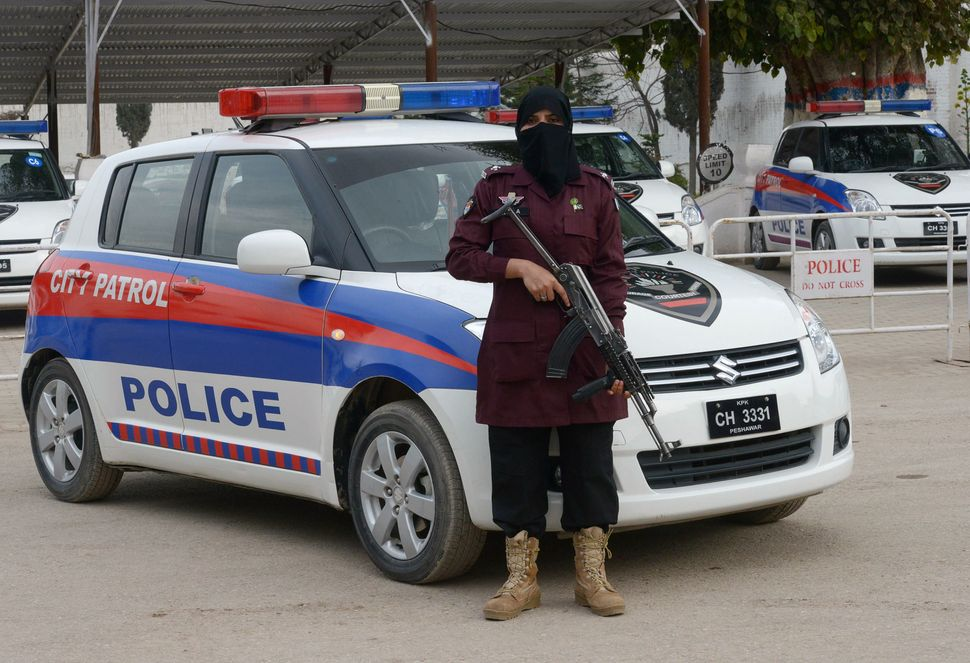 Zahida, a police assistance sub-inspector, poses for a photograph at a police academy in Peshawar, Pakistan, onFeb. 26,
