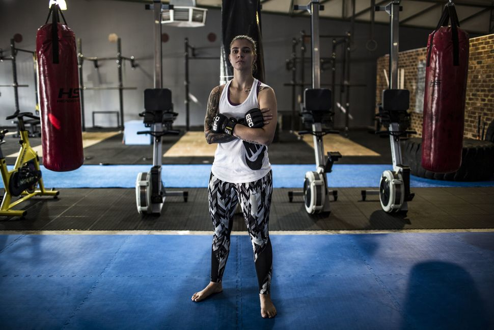 Mixed martial arts fighter Shana Power, 25, poses for a picture in the gym she co-owns in Johannesburg, South Africa, on&nbsp