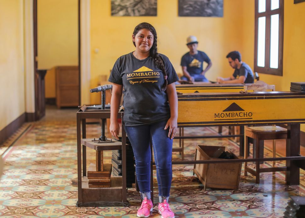 Betania Gutierrez, a tobacco roller at the Momotombo Factory, poses in Granada, Nicaragua, onFeb. 26, 2018.