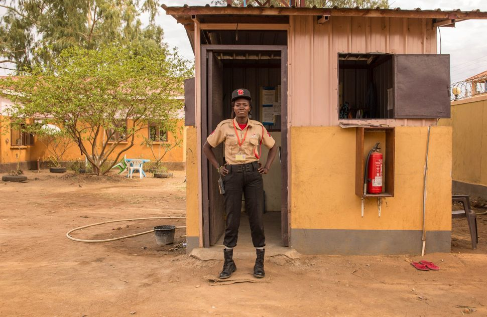 Security guard Marlin Keji John, 30, poses in Juba, South Sudan, on Feb. 22, 2018.