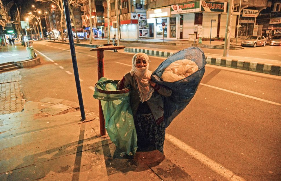 Ayniye Kaya, a 78-year-old Kurdish woman, collects garbage in the streets of Diyarbakir, Turkey, on Feb. 23, 2018.