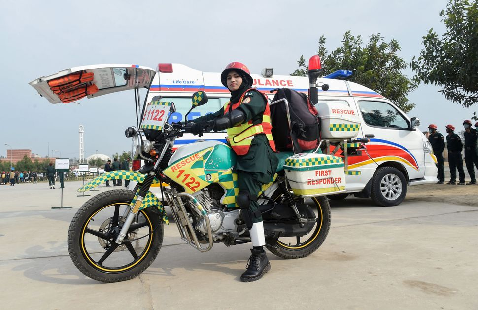 First responder Samra Akram Zia poses for a photograph with her motorcycle ambulance in Lahore, Pakistan, onFeb. 24, 20