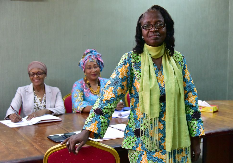 Mariatou Guiehoa is the president of The Network of Women Trade Unionists of Ivory Coast. Here she poses next to co-work