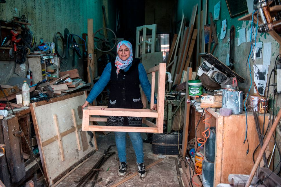 Asmaa Megahed is a 31-year-old Egyptian carpenter. Here she poses for a picture at her workshop in the Abdeen district in dow