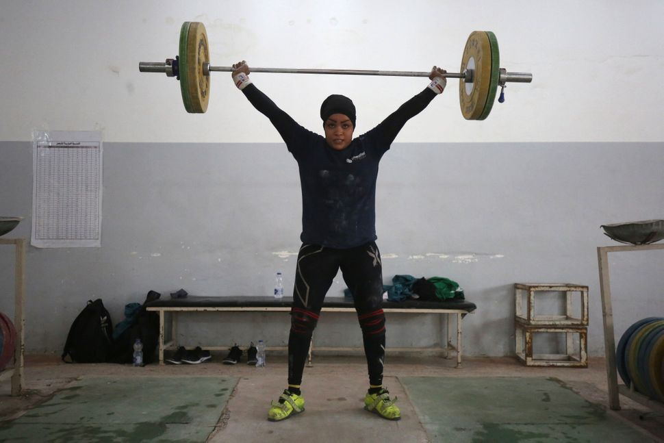 Huda Salem, a 20-year-old member of the Iraqi national weightlifting team, trains at a gym in Baghdad onFeb. 22, 2018.