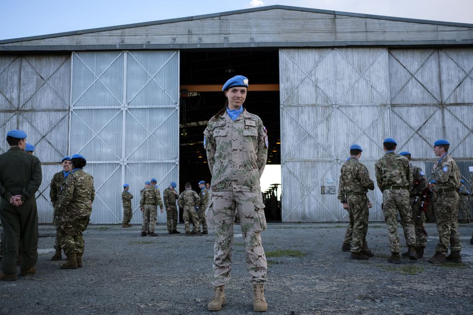 Slovak U.N. peacekeeper Lt. Ivana Strycekova poses for a picture prior to a peace medals ceremony at an old airport in N