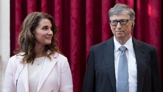 Philanthropist and co-founder of Microsoft, Bill Gates (R) and his wife Melinda listen to the speech by French President Francois Hollande, prior to being awarded Commanders of the Legion of Honor at the Elysee Palace in Paris, France, April 21, 2017.     REUTERS/Kamil Zihnioglu/Pool