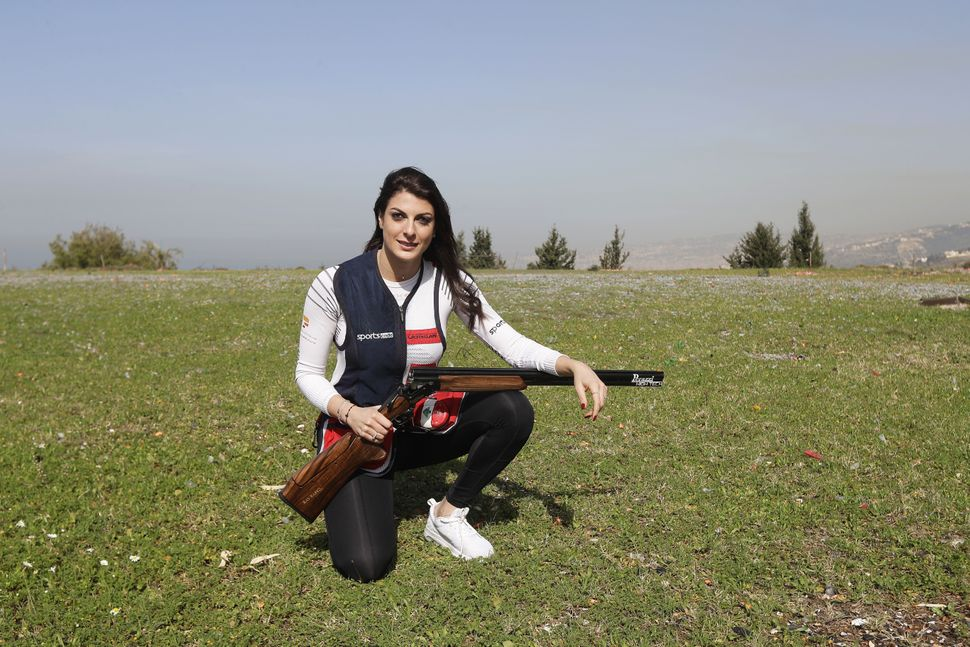 Ray Bassil, 29,is a Lebanesetrapshooting champion and UNDP youth and gender goodwill ambassador. Here she poses f