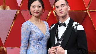 US figure skater  Mirai Nagasu (L) and US Olympic medalist Adam Rippon arrive for the 90th Annual Academy Awards on March 4, 2018, in Hollywood, California.  / AFP PHOTO / ANGELA WEISS        (Photo credit should read ANGELA WEISS/AFP/Getty Images)