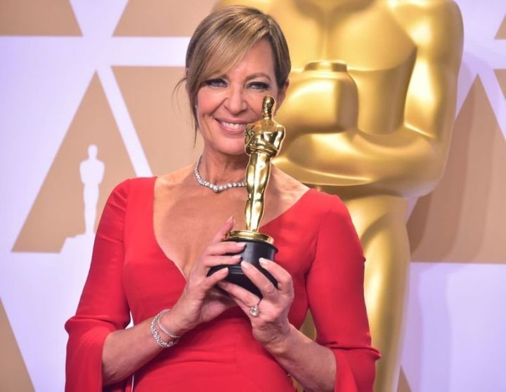 Allison Janney holds up her Oscar during the 90th Academy Awards in Hollywood.