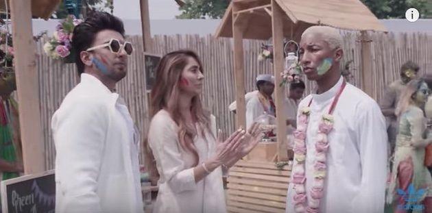 Pharrell Williams listens as Bollywood starRanveer Singh and presenterAnusha Dandekar explain...