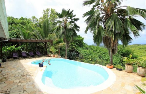 This three bedroom villa features a terrace, private pool with panoramic views of the sea and hills. The Creole-style villa i