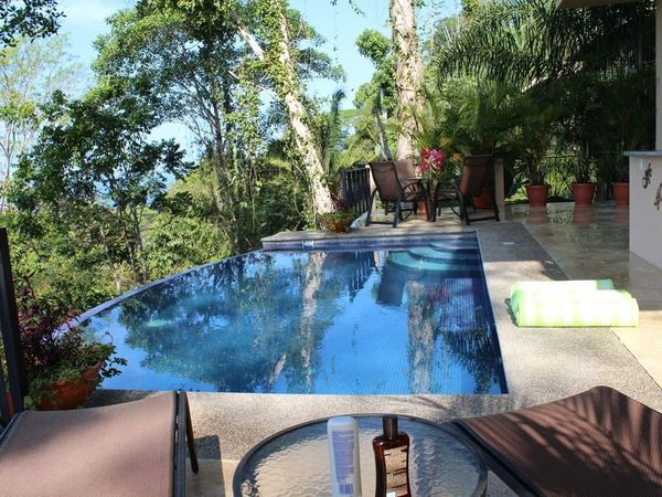 Known as the Flying Monkey Villa, this property is nestled in the jungle and provides stunning panoramic ocean and jungle vie