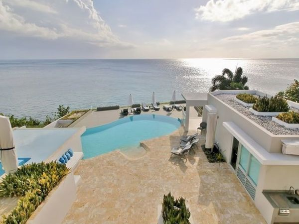 This exclusive and private seven-bedroom villa is set on a private oceanfront landscape on the island. It includes a private