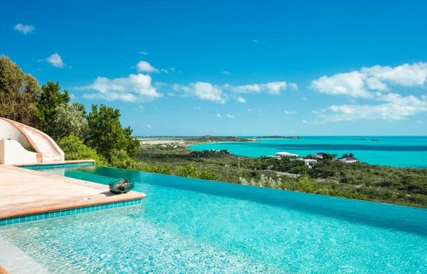 Only a 10-minute drive to the world-renowned Grace Bay Beach, this luxury villa is nestled along the Turtle Tail area of the