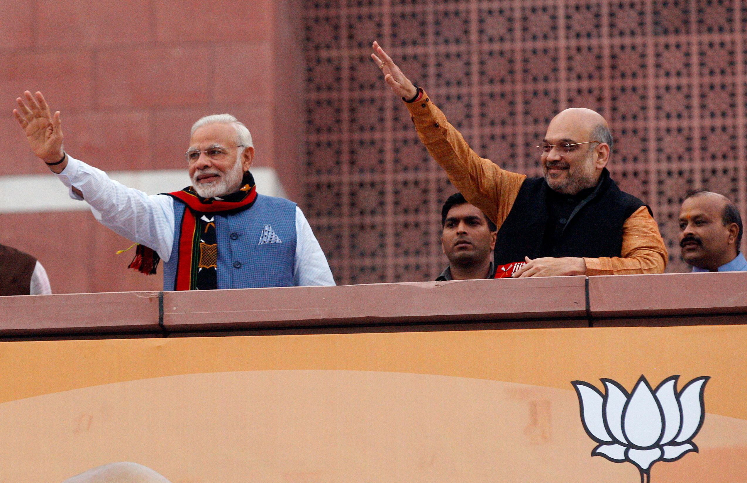 NEW DELHI, INDIA  MARCH 03: Prime Minister Narendra Modi and BJP President Amit Shah arrives to address BJP party workers after their victory in North-East Assembly election at party headquarters in New Delhi. (Photo by Qamar Sibtain/India Today Group/Getty Images)
