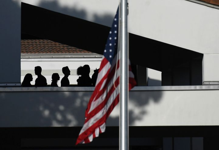 A flag flies at half-staff as students return to Marjory Stoneman Douglas High School on Wednesday February 28 in Parkland, F