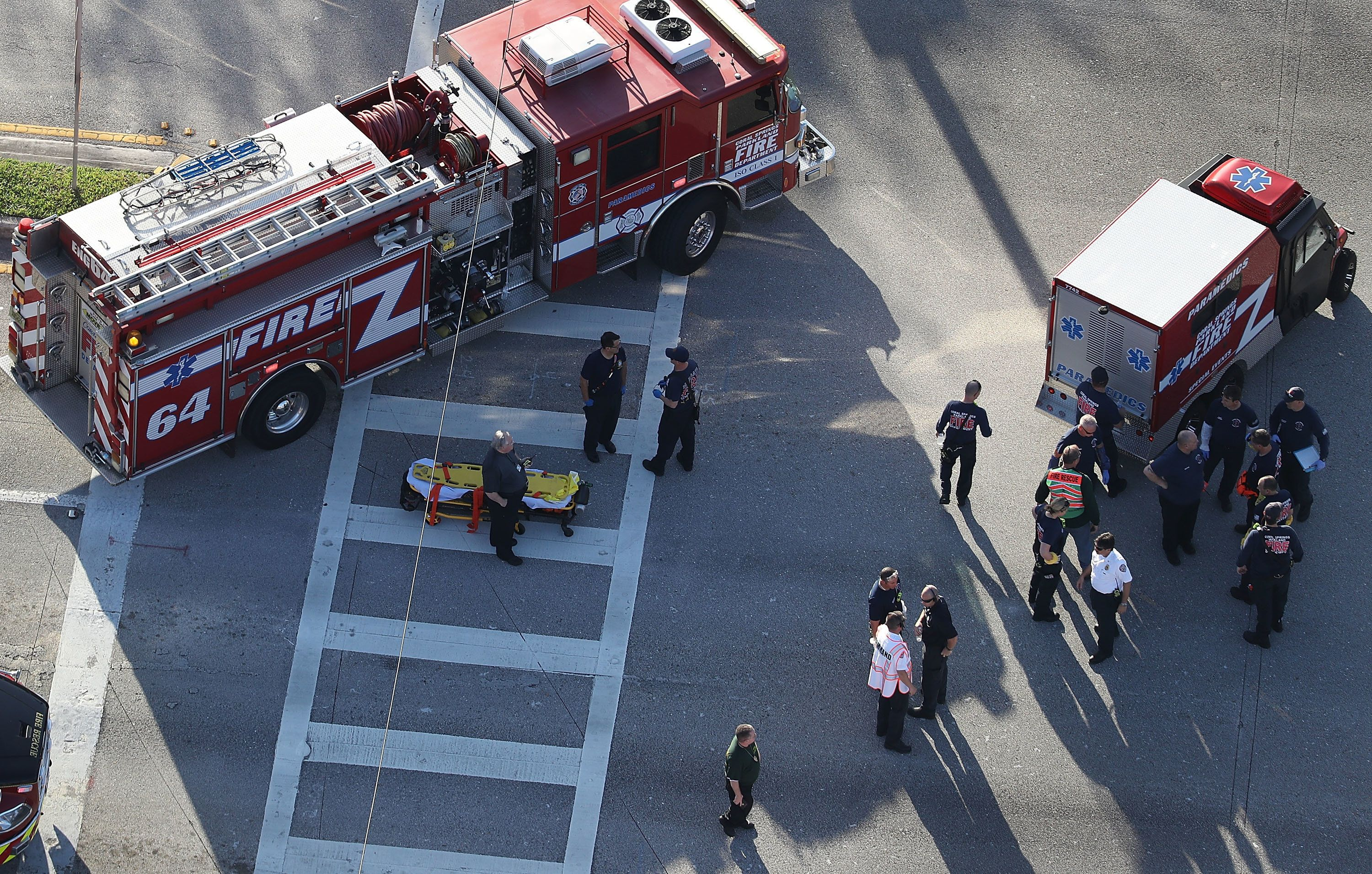 PARKLAND, FL - FEBRUARY 14:  Fire Rescue personnel work the scene at the Marjory Stoneman Douglas High School after a shooting at the school that reportedly killed and injured multiple people on February 14, 2018 in Parkland, Florida. Numerous law enforcement officials continue to investigate the scene.  (Photo by Joe Raedle/Getty Images)