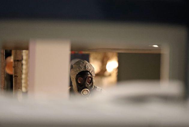 Investigators inside the Zizzi restaurant in Salisbury near to where former Russian double agent Sergei...