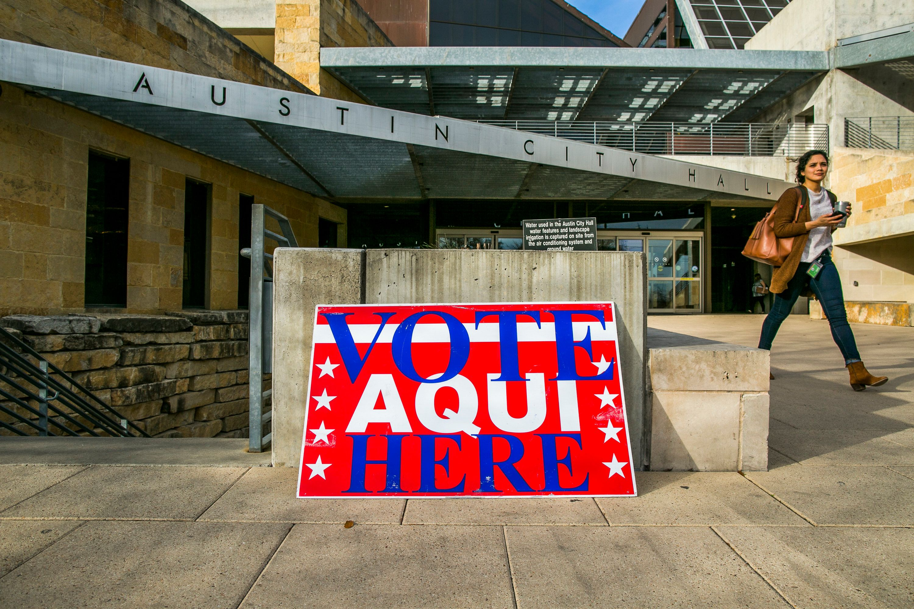 AUSTIN, TX - MARCH 06: A pedestrian walks past Austin City Hall, an early voting center, on March 6, 2018 in Austin, Texas. Democrats are seeing a large increase in voter turnourt compared to last year. (Photo by Drew Anthony Smith/Getty Images)