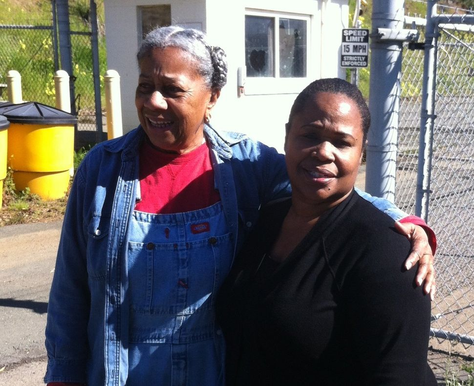 Apache Dodson (left) with local environmental justice activist LaDonna Williams.