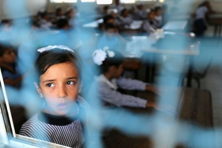 A Palestinian girl attends a lesson on the first day of the new school year at a United Nation-run school in the Gaza Strip.