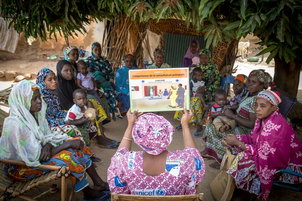 Mama Yeleen Fatoumata Ouattara leads a group