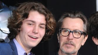 HOLLYWOOD, CA - FEBRUARY 10:  Actor Gary Oldman (C) and his sons Gulliver Flynn Oldman (L) and Charlie John Oldman (R) attend the Los Angeles premiere of 'Robocop' on February 10, 2014 at TCL Chinese Theatre in Hollywood, California.  (Photo by Barry King/FilmMagic)