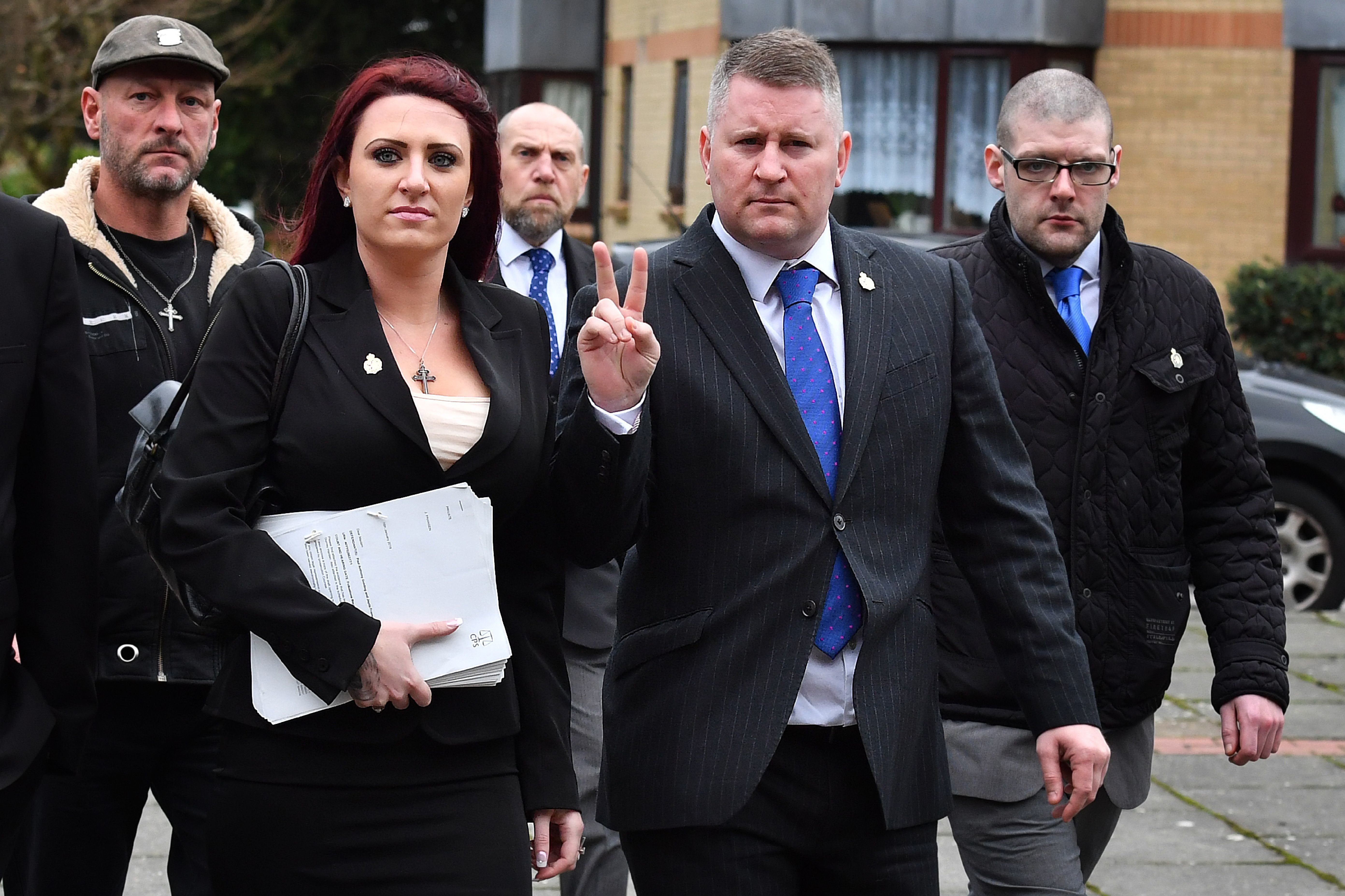 Far-right group Britain First leader Paul Golding (R) and deputy Jayda Fransen arrive at Folkestone magristrates court in Kent on January 29, 2018. They stand accused of causing religiously aggravated harassment.  / AFP PHOTO / BEN STANSALL        (Photo credit should read BEN STANSALL/AFP/Getty Images)